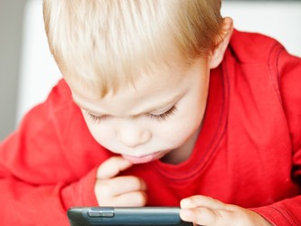 little boy with media player